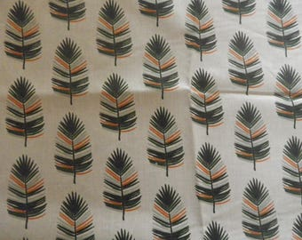"""fabric """"feathers"""" on a beige background"""