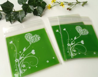 10 pockets green hearts 10cmx10cm transparent gift bags