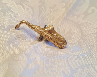 Goldtone Saxophone tie tac. Very detailed!