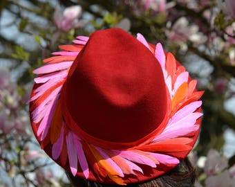 Red woolfelt fedora with feathers