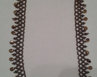 Beaded necklace, bronze colour, glass beads.