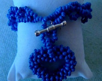 blue heart pendant and chain bracelet