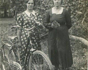 Mother and daughter posing with bicycle antique rppc photo