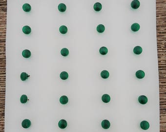 A sample card of vintage green glass diminutive buttons c1920/30s. 0.5cms