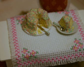 "Dollhouse Miniature CAKE in a plate with "" white cream "" on top and ""colored sugar pearls"""