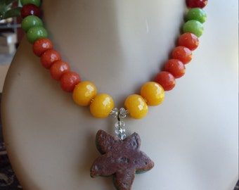 One strand beaded necklace with center drop