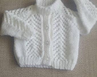 Hand knitted newborn baby cardigan in white