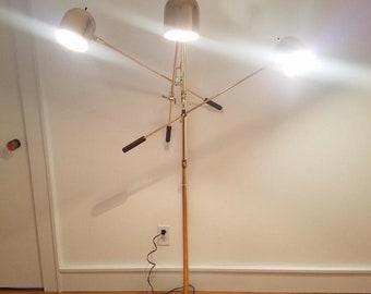 Gold Mid Century Modern three armed articulating floor lamp