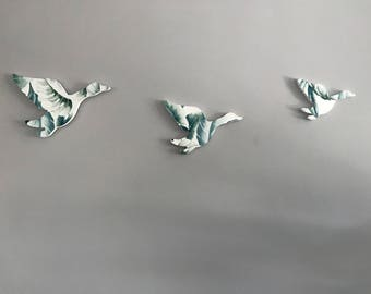 Trio of Flying Geese Wall Decorations with Monstera Print on White Background