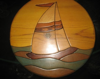 Five shades of stain Round Wood Sailboat wall hanging
