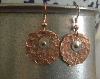 LYNN:  Hammered copper rounds with sterling silver rounds riveted with copper.  Hand made