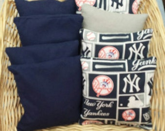 8 Corn Hole Game Bags 4 in NY Yankees team print  and 4 in either Red or Navy Duck Canvas