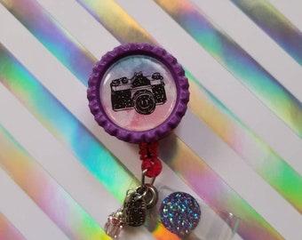 Watercolor camera badge reel