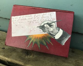 Newton's comet - an ephemera collage, layered on an old book - 745