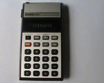 Vintage 1980s Casio H-1 calculator Green LED display. Works