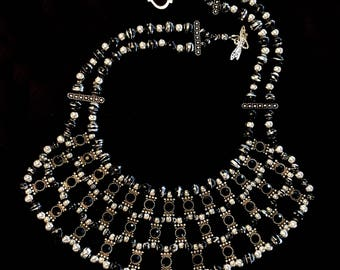 Black and silver bib-style statement necklace