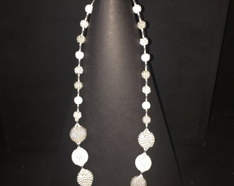 Beautifully made beaded necklaces in shades of white