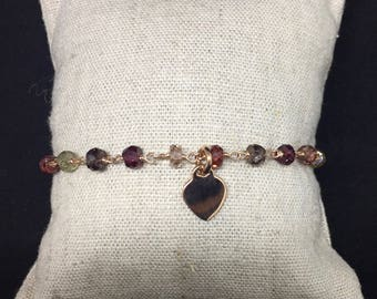 Bracelet with multicolor beads and pink gold heart