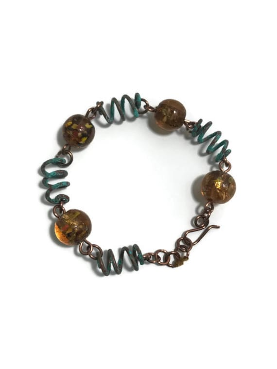 Rustic copper patina coil bracelet with glass beads