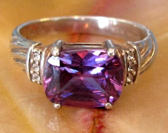 Size 8 Sterling Silver and Amethyst Purple Stone Ring by Avon Late 80's