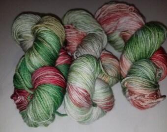 "Dana, a hand-dyed superwash merino wool/nylon blend sport weight yarn. 274yds/100gms/hank. 6sts=1""on #:3-5 needles."