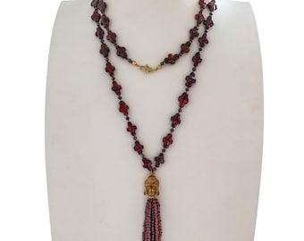 Freshwqater pearls with garnet tassel