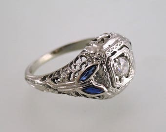An Antique 18k White Gold and Diamond Filigree Ring with Blue Sapphire Accents, Circa 1930's (A1881)