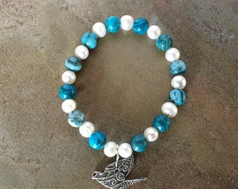 Blue Jasper and fresh water pearl stretch bracelet with 999F.S. precious metal clay dove charm