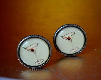 Mod vintage 60s ,silver tone metal  , round cuff links with a sage lucite and hand painted martini glass and cherry. Made by Shield.