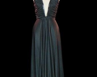 Luis Estevez leather trimmed black maxi dress, sexy 1970s jersey halter gown, plunging neckline, waist deep décolleté, sleeveless, backless