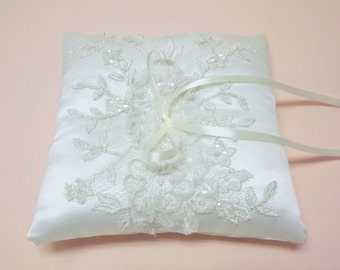 Ivory wedding ring pillow decorated with floral lace. Ivory silk satin ring bearer.