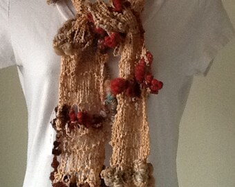 Unique knitted scarf with zig zag ribbon and hand spun bobbles