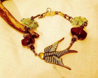 Soaring Brass Swallow with jade Bracelet: soaring swallow bracelet, flying bird bracelet, brass and ruby Jade bracelet,  patinated filigree.