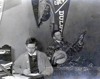 Vintage photo 1913 College Boys Dorm Room Pennants Plays Banjo Music and SMokes