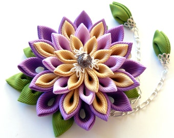 Kanzashi fabric flower hair clip. Shades of purple, toffee and apple green.