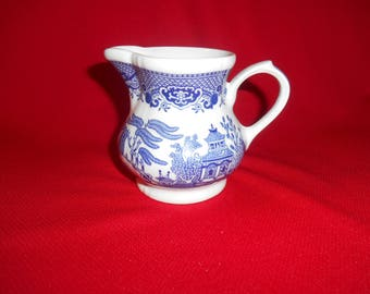 "One (1), 3 5/8"", 8 oz. Creamer from Churchill, in the Georgian Shape, Willow Blue Pattern."