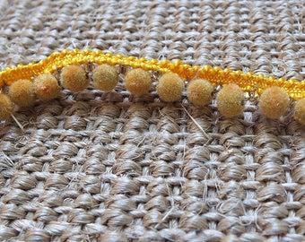 Yellow pom-pom trim