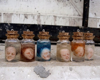 Miniature head in a jar Goth pendant Weird stuff witch jewelry Creepy jewelry Terrarium jewelry Doll head necklace Shrunken head Odd gift