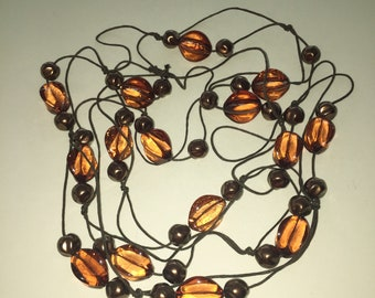 Chunky Dark Amber Rose Lucite Floating Bead Necklace.