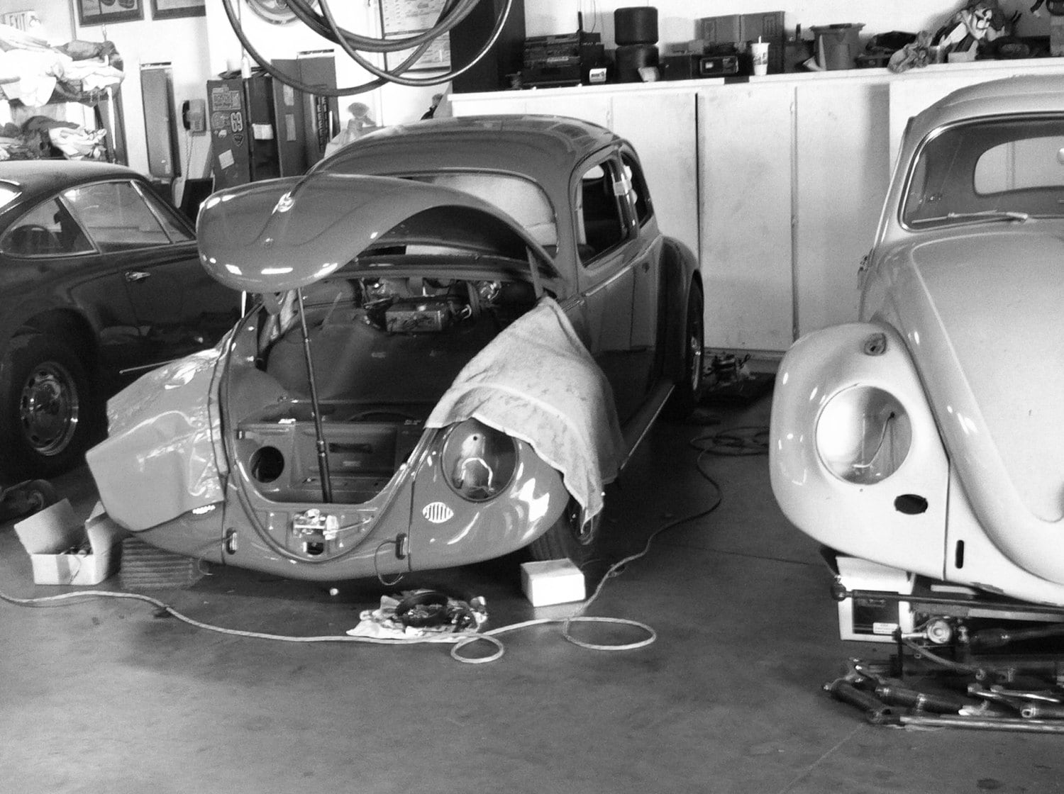 black and white Photograph of vintage cars in workshop VW