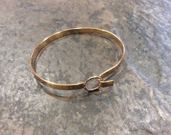 Buckle Loop Bangles Oval shaped with round loop detail and shiny gold band
