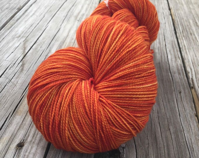 hand dyed sock weight yarn Lusty Wench Orange Shawl Length Superwash Merino Cashmere Nylon MCN 600 yards fingering weight pumpkin tangerine