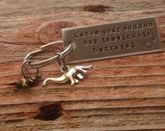 "Hand stamped ""Curse your sudden but inevitable betrayal"" Firefly inspired keychain with dinosaur charm"