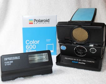 Rebuilt Polaroid SX70 Autofocus Bundle - Updated to use 600 Film Cartridges - New Flash, Film and Frog's Tongue Included