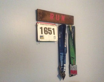 race bib and medal holder