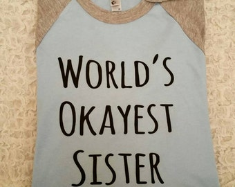 World's Most Okayest Sister - Sister Shirt - Worlds Most - Okay Sister - OK Shirt - Sisters Gift