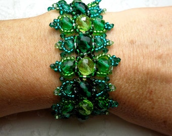 Designer bracelet peridot and emerald green Czech glass beads woven high fashion