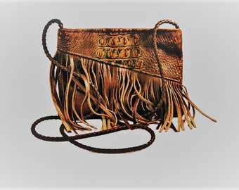 Leather hand bag with fringe and a western flare