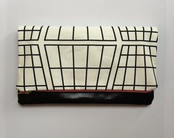 Leather clutch bag with monochrome print fabric and pink zipper, small