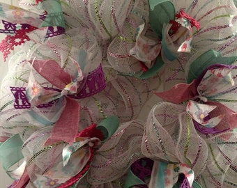 Bright spring multi-color wreath with spring colored ribbons